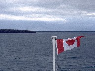 Canadian flag on ferry in Tobermory harbor, Ontario, Canada, 1997